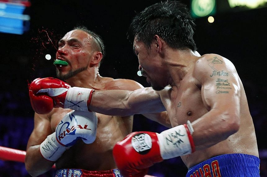 Manny Pacquiao landing a punch that leaves Keith Thurman bloodied in their WBA welterweight title fight at the MGM Grand Garden Arena in Las Vegas, Nevada, on Saturday night. Pacquiao won by a split decision.