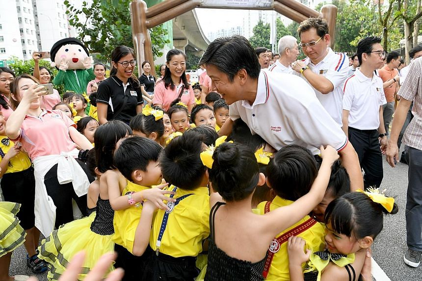 Kindergarten children from the Pasir Ris-Punggol GRC giving a group hug to NTUC secretary-general Ng Chee Meng, who is also Minister in the Prime Minister's Office, at the Pasir Ris-Punggol Inter-Racial and Religious Harmony Street Parade 2019 yester