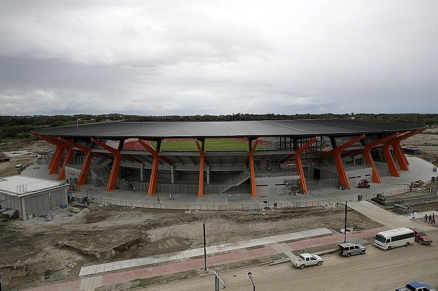 A view of the athletics stadium for the 30th SEA Games in New Clark City on Friday. Main venues for the games are nearing completion but works on other facilities are still in progress.