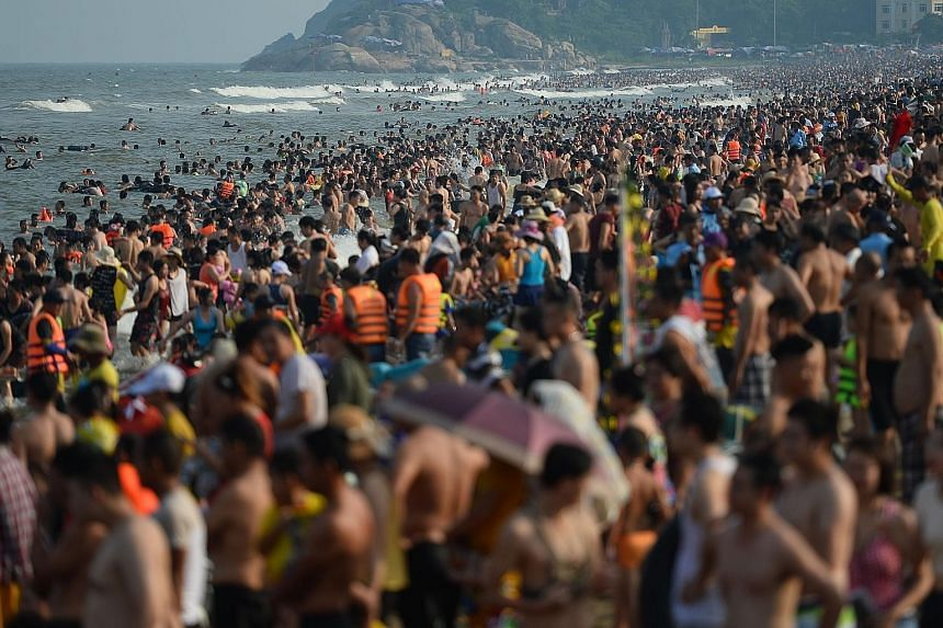 Thousands of day trippers jostling for selfie space and elbowing their way to the sea at north Vietnam's popular Sam Son beach last Saturday, as extra-vigilant lifeguards kept watch over the summer surge. Located in Thanh Hoa province, the beach has