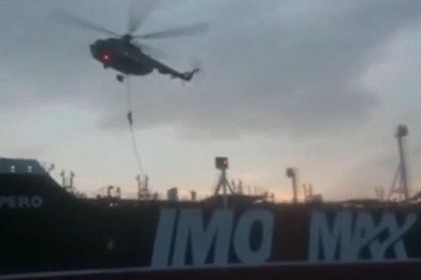 An image grab from a video provided by Iran's Revolutionary Guard official website shows Iranian forces boarding the British-flagged tanker Stena Impero in the Strait of Hormuz last Friday.