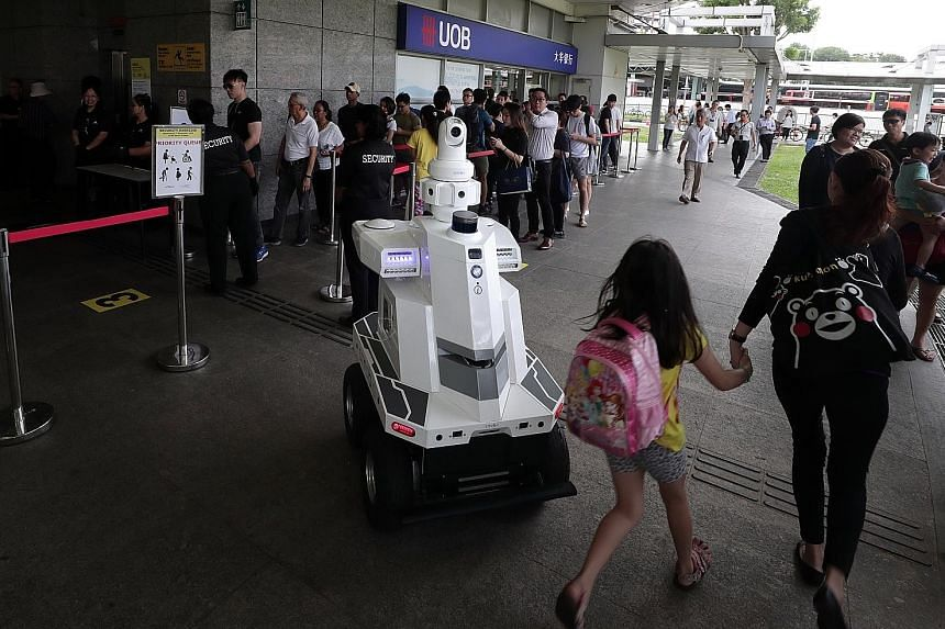 """An ST Engineering roving robot with surveillance capabilities deployed during """"Exercise Station Guard"""" at the Hougang MRT Station last December. Innovation is a big part of the defence technology group's growth plan, says Mr Vincent Chong, its president a"""