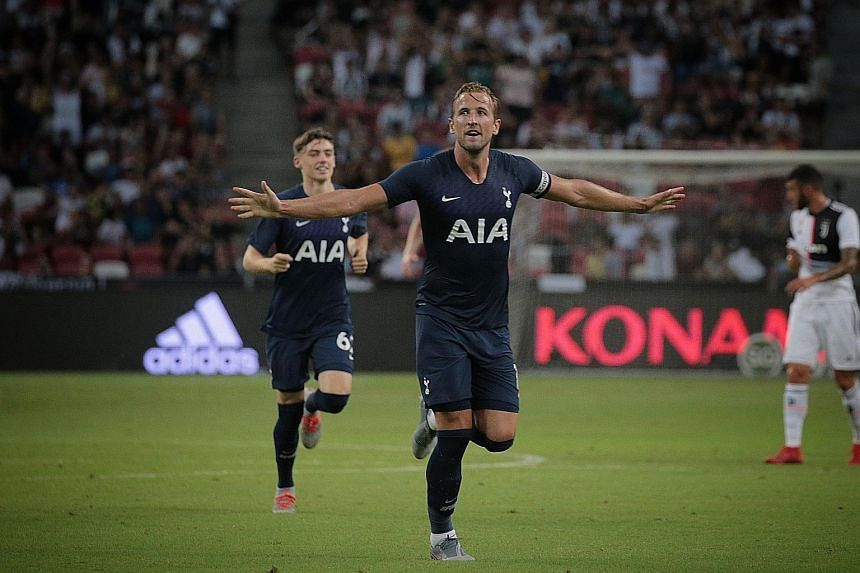 Tottenham striker and captain Harry Kane celebrates after scoring the winner - a stupendous lob from near the halfway line - in the 3-2 win over Juventus last night.