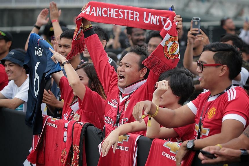 Manchester United fans at The Float @ Marina Bay.