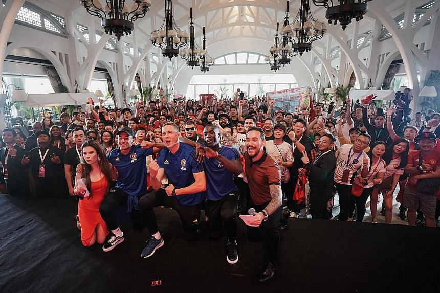 Red Devils (in blue, from left) Jesse Lingard, Nemanja Matic and Eric Bailly cheering with fans at an event organised by Chivas Regal at The Clifford Pier, Fullerton Bay Hotel.
