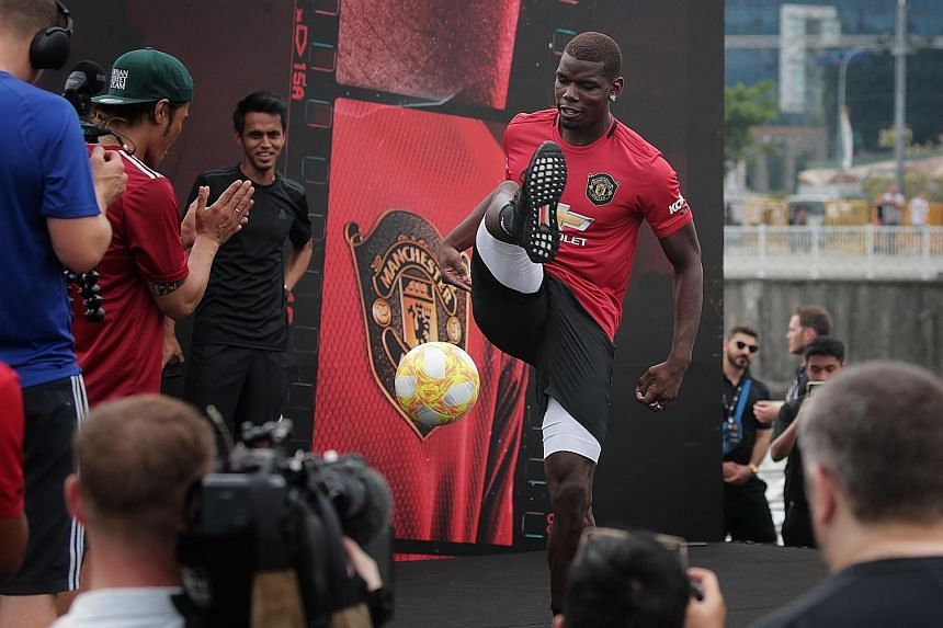 Paul Pogba showing off his ball-juggling tricks at a sponsor's event at The Float @ Marina Bay.