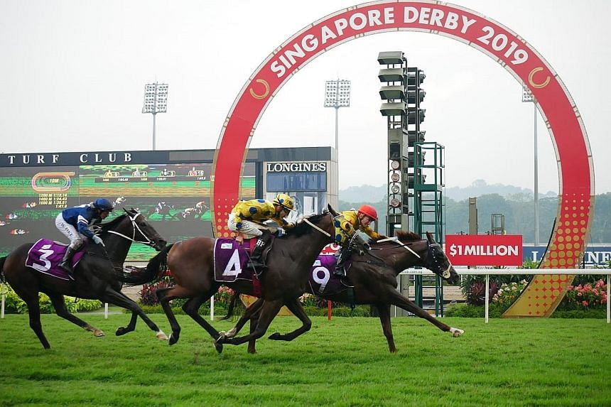 Sun Marshal staving off stablemate Mr Clint (No. 4) in the $1 million Group 1 Singapore Derby yesterday.