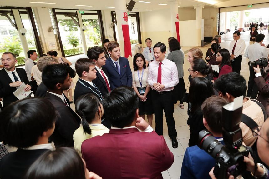Trade and Industry Minister Chan Chun Sing (in pink) encouraged student leaders to have the courage and leadership to build bridges and realise the benefits of a globally integrated system.