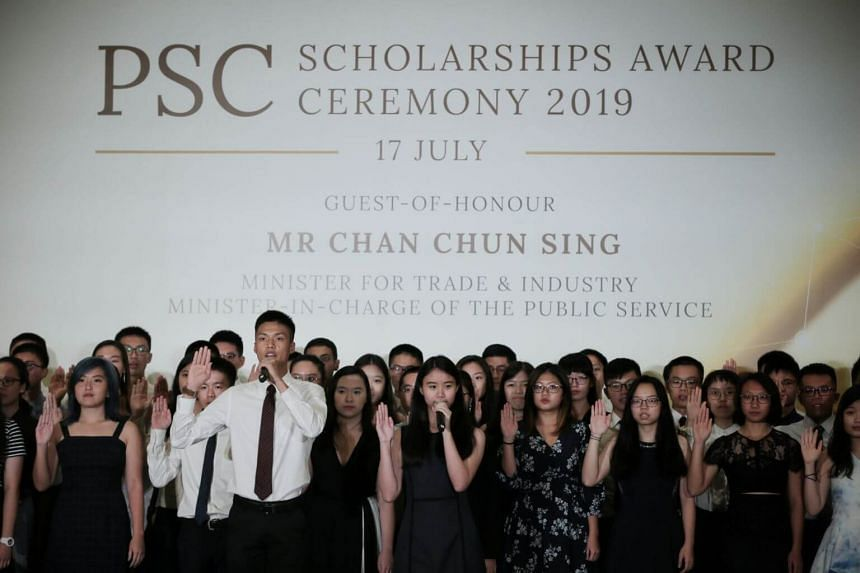 Scholarship recipients recite the PSC Scholarship Holder's Pledge at the 2019 PSC Scholarships Award Ceremony.