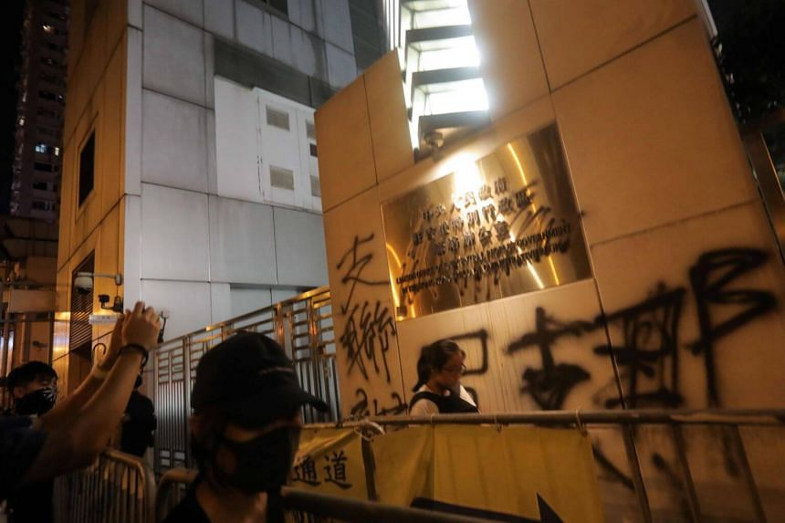 Thousands of protesters gathered outside China's Liaison Office on July 21, 2019, throwing eggs and spray-painting graffiti on its walls.