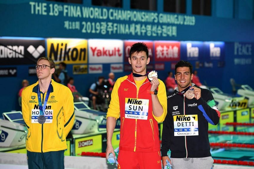 Silver medallist, Australian swimmer Mack Horton (first from left), snubbed Chinese champion Sun Yang (centre) after the 400m freestyle medal ceremony. Italy's Gabriele Detti won the bronze medal.