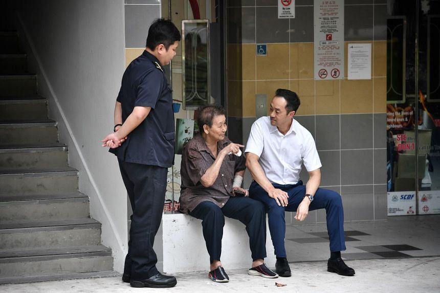 Ang Mo Kio GRC MP Koh Poh Koon speaking to a resident who lives on the fifth floor of the affected block.