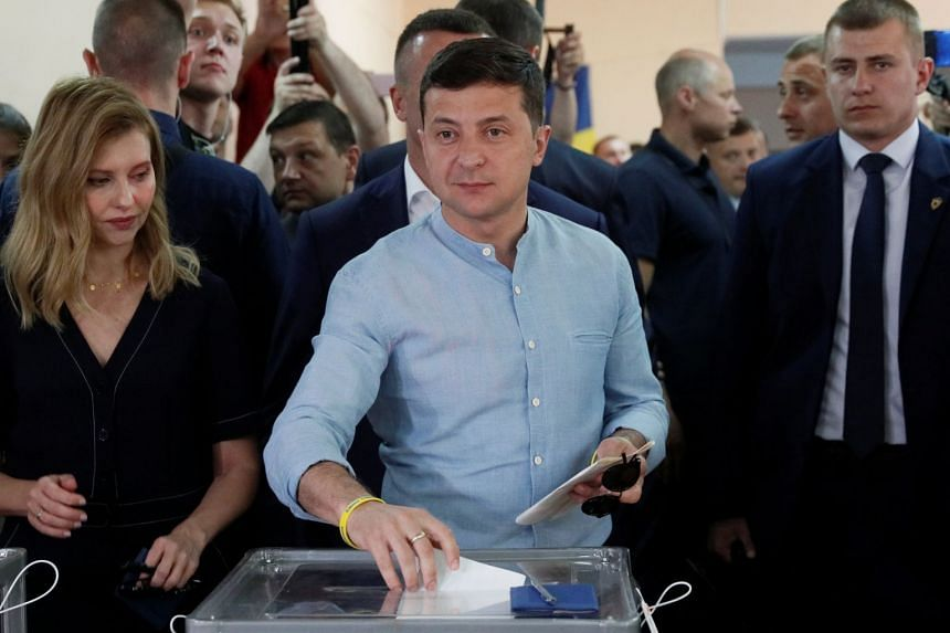 Ukraine's President Volodymyr Zelenskiy casts his ballot at a polling station during the parliamentary election in Kiev, Ukraine, on July 21, 2019.