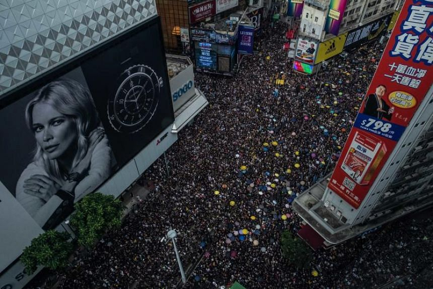 Protesters take part in a march in Hong Kong on July 21, 2019.