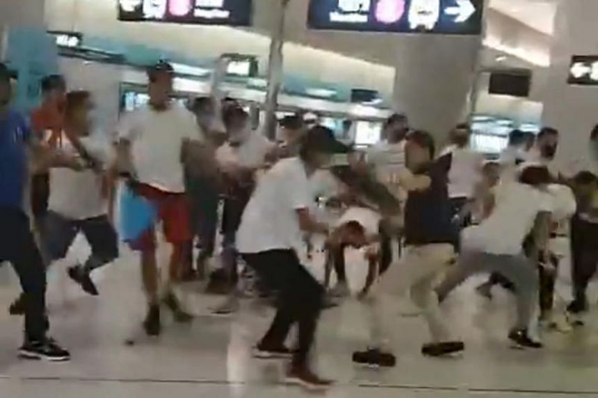 A mob of men in white T-shirts clashing with pro-democracy protesters on the platform of Yuen Long station in Hong Kong on July 21, 2019.