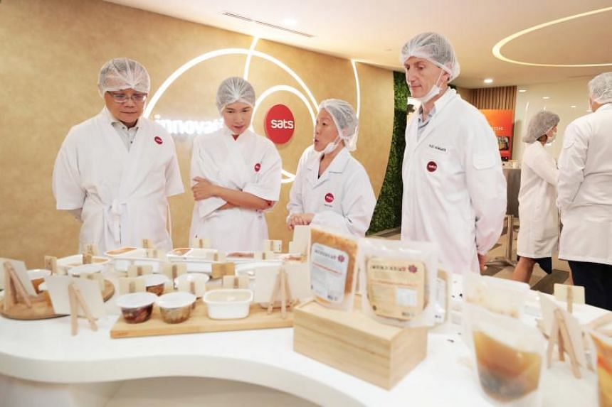 At the Sats Inflight Catering Centre 2 on July 22, 2019, were (from left) Workforce Singapore chief executive Tan Choon Shian, Manpower Minister Josephine Teo, Sats vice-president of innovation and product development Jean Sin, and Sats president and