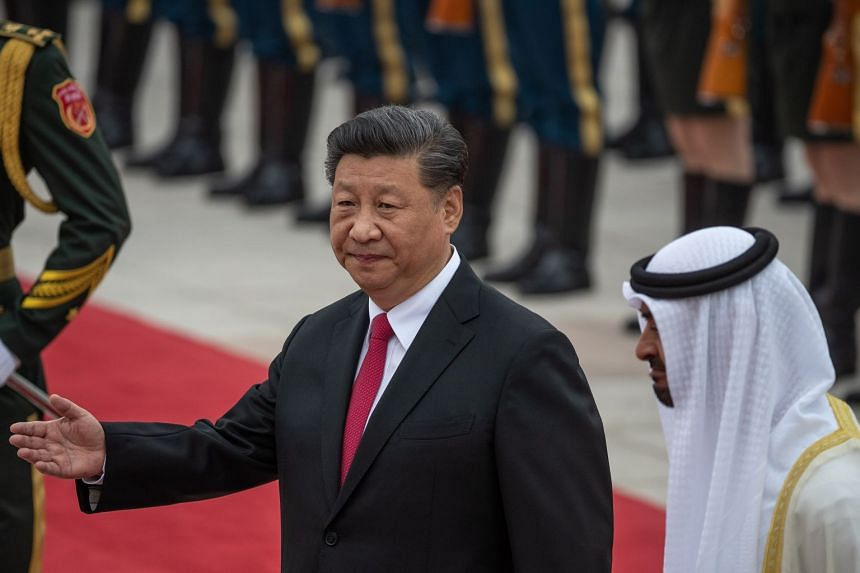 China's President Xi Jinping (left) and Abu Dhabi's crown prince, Sheikh Mohammed bin Zayed Al Nahyan (right) inspect an honour guard during a welcome ceremony at the Great Hall of the People in Beijing, July 22, 2019.