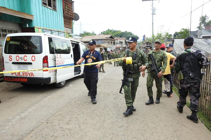 Security forces and scene of the crime operatives cordoning off an area in Indanan town in the Philippines' Sulu province after a blast on June 28, 2019.