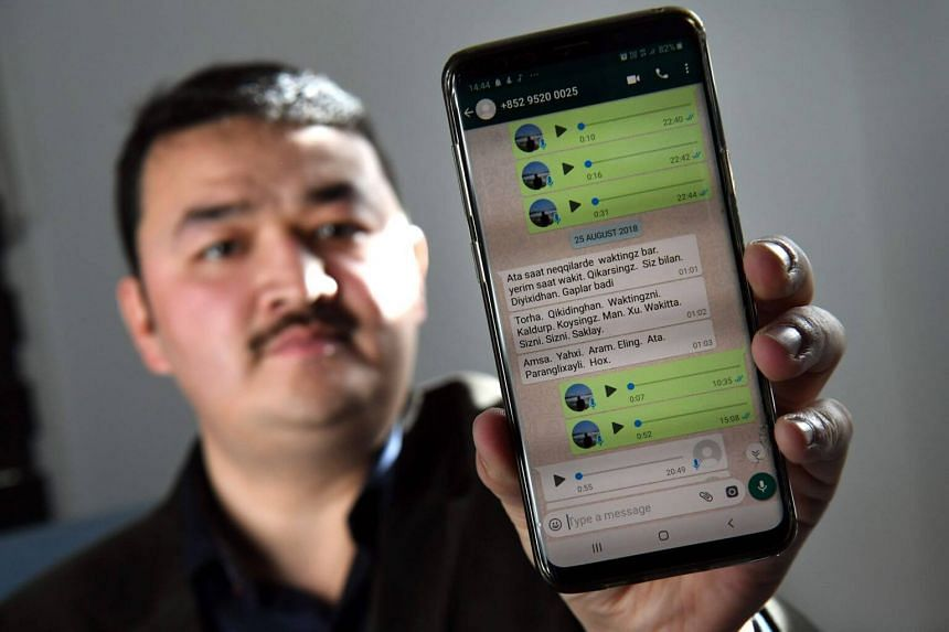 Melbourne-based Uighur refugee Shir Muhammad Hasan displaying messages on his phone at his Melbourne home.