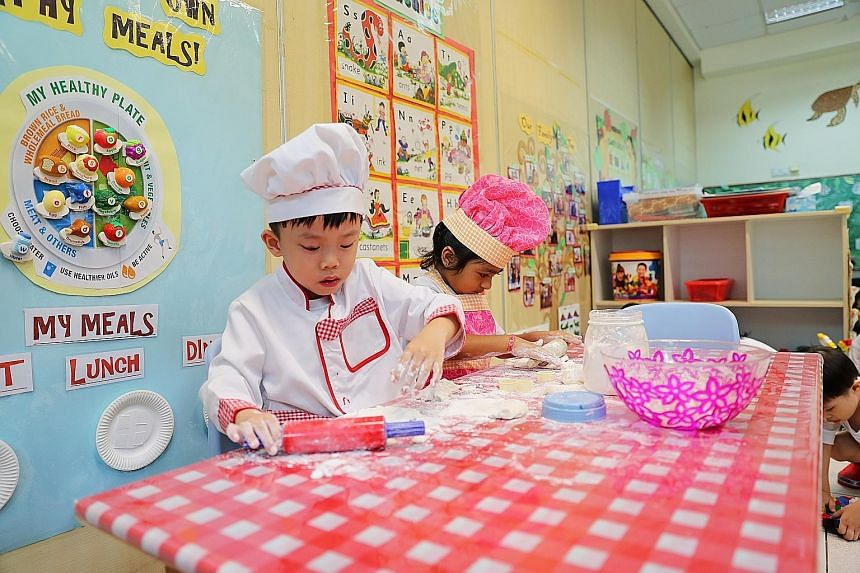 Children role-playing as chefs (above) and having a lesson with Chinese teacher Lu Bin (left) at Zion Kindergarten. The school is holding an open-house carnival to boost enrolment. Pre-schoolers having a gym class (left) at Zion Kindergarten, which i