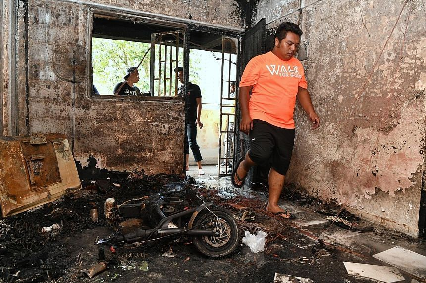 The blackened interior of a flat at Block 224 Ang Mo Kio Avenue 1 after a fire broke out on Monday. The blaze is believed to have been caused by the overcharging of an electric scooter.