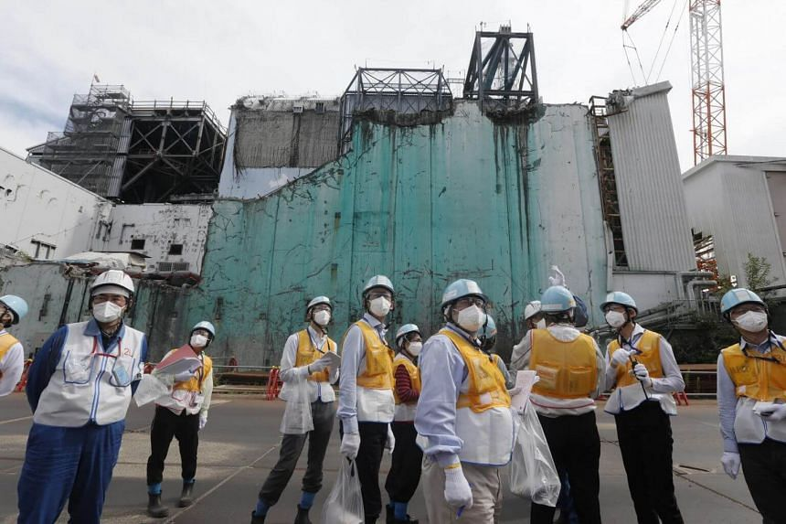Journalists receiving information about decommissioning works at the Fukushima Daiichi nuclear power plant in 2018.