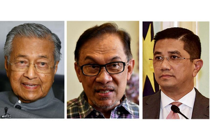 Datuk Seri Azmin Ali (right) was introduced to Datuk Seri Anwar Ibrahim (centre) by Malaysia's Prime Minister Mahathir Mohamad in 1987 when, as a bright-eyed 23-year-old graduate, he was made special officer to the then education minister.