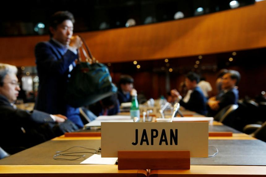Members of the Japan delegation arrive for a World Trade Organization meeting in Geneva where the worsening trade and diplomatic dispute between South Korea and Japan will be raised, on July 24, 2019.