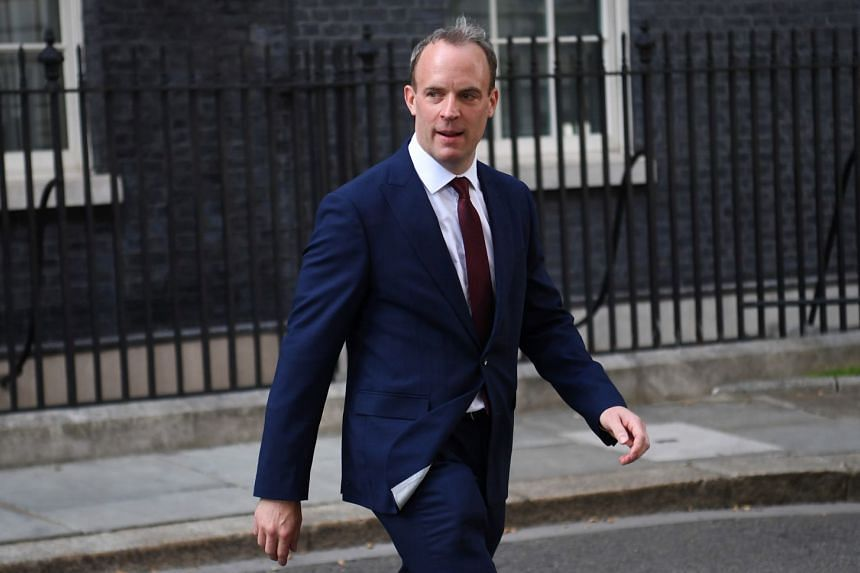 New foreign minister Dominic Raab leaves after a Cabinet re-shuffle at Downing Street in London.