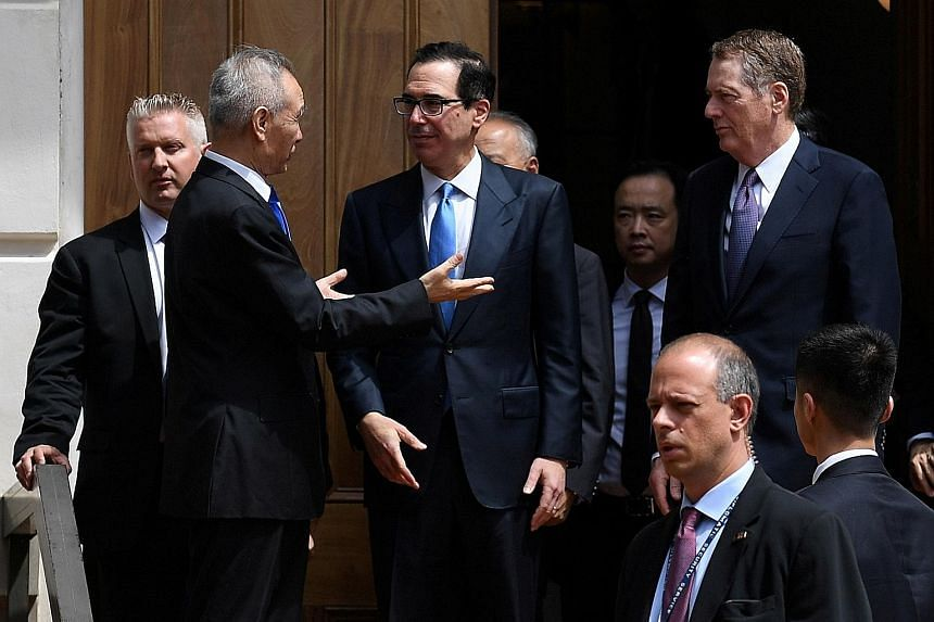 Chinese Vice-Premier Liu He conversing with US Treasury Secretary Steven Mnuchin, with Trade Representative Robert Lighthizer looking on, after trade talks in Washington broke down in May.
