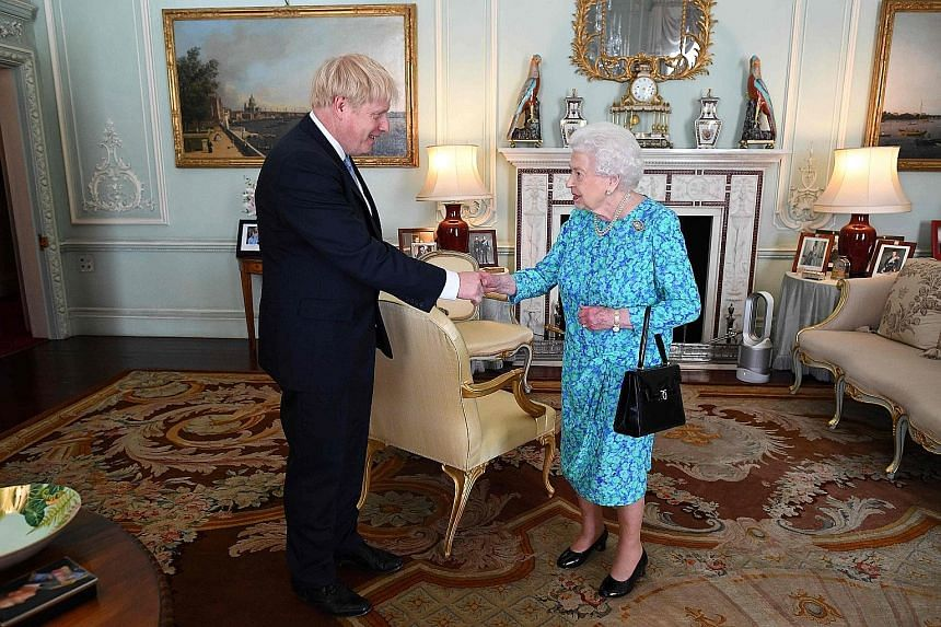 """Queen Elizabeth meeting Britain's new Prime Minister Boris Johnson at Buckingham Palace yesterday. Mr Johnson has vowed to implement the result of the 2016 Brexit referendum and lead Britain out of the European Union on Oct 31 with """"no ifs or buts""""."""