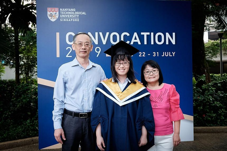 Miss Felicia Lim with her parents, Mr Lim Bon Kee and Madam Noreen Chia, at her graduation ceremony in Nanyang Technological University on Tuesday.