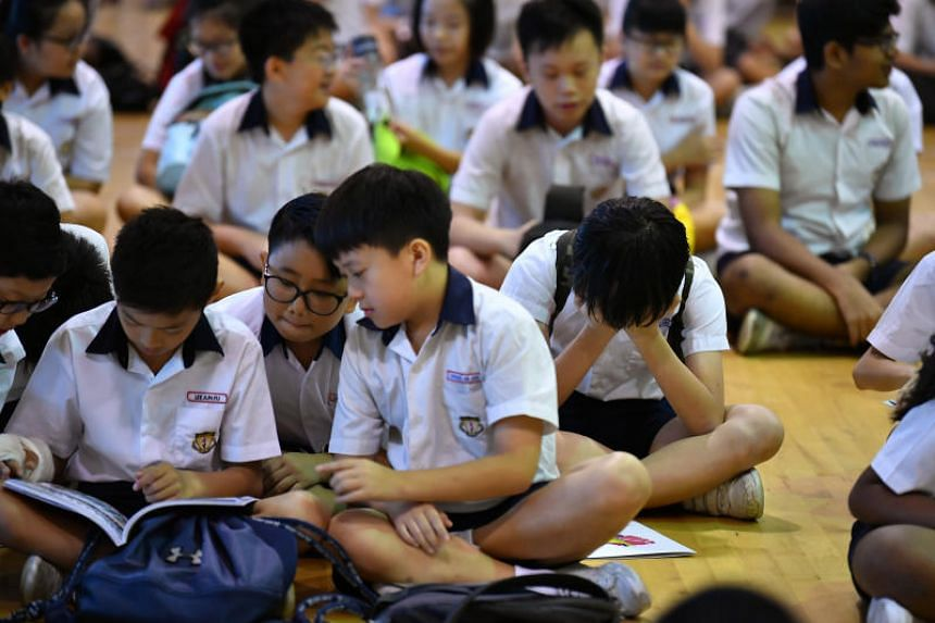 Geylang Methodist School (Primary) pupils waiting for the release of their Primary School Leaving Examination results on Nov 22, 2018.