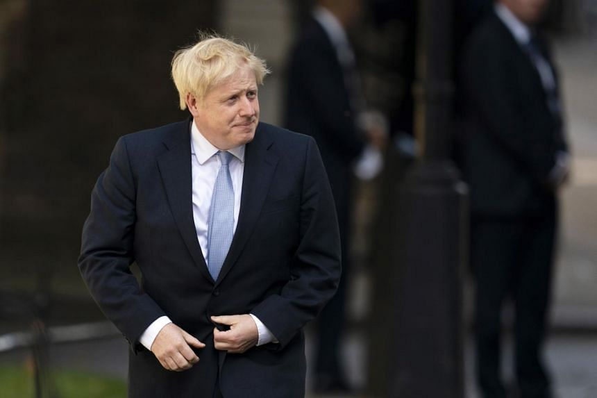 Tehran's ultra-conservative Resaalat newspaper published a cartoon Wednesday of Boris Johnson as a British butler being patted on the head by US President Donald Trump in the Oval Office.