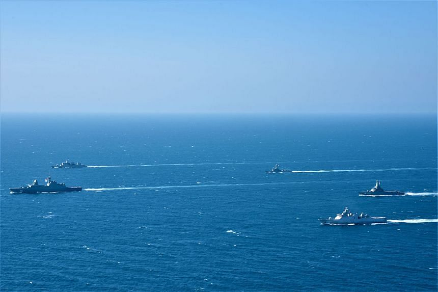 Singapore and Indonesian navy vessels sailing in formation during the 25th edition of Exercise Eagle Indopura, the Singapore Armed Forces' longest-running bilateral exercise with a foreign military.