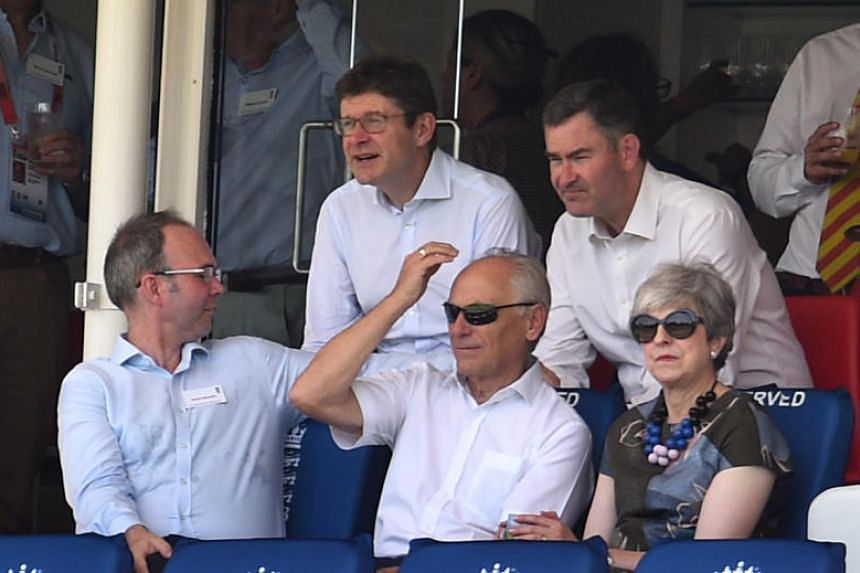 Britain's former prime minister Theresa May was joined by Conservative colleagues David Gauke (top right) and Greg Clark (top left), who left their respective roles as justice and business secretaries during a brutal Cabinet reshuffle.
