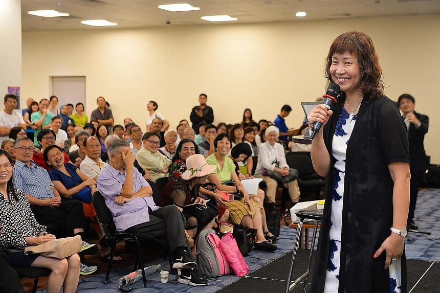 The Sunday Times Invest editor Lorna Tan giving retirement advice to about 300 people who attended her askST@NLB talk at the Central Public Library in Victoria Street on Wednesday.