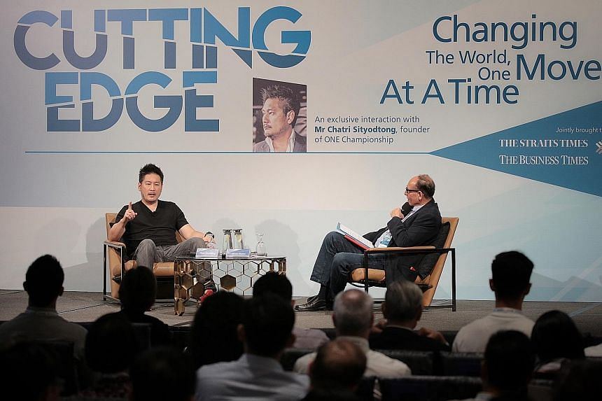 Mr Chatri Sityodtong (at left), founder of One Championship, at the Cutting Edge forum yesterday with Straits Times associate editor Vikram Khanna, who moderated the question-and-answer session. At the event, Mr Chatri shared lessons from his rags-to