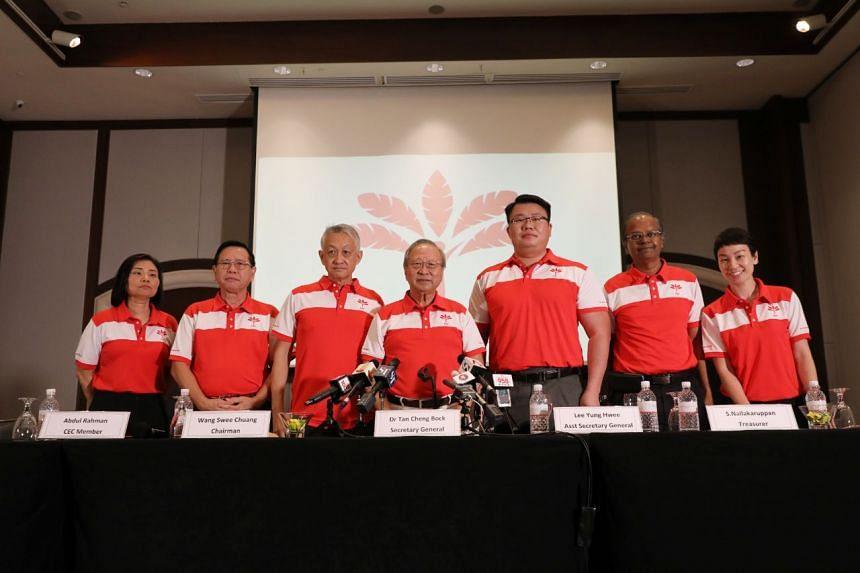 (From left) Ms Hazel Poa, assistant treasurer; Mr Abdul Rahman, CEC member; Mr Wang Swee Chuang, chairman; Dr Tan Cheng Bock, secretary general; Mr Lee Yung Hwee, assistant secretary general; Mr S.Nallakaruppan, treasurer; and Ms Michelle Lee, CEC me