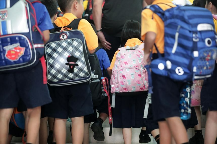 School children carrying their bags on July 4, 2019.
