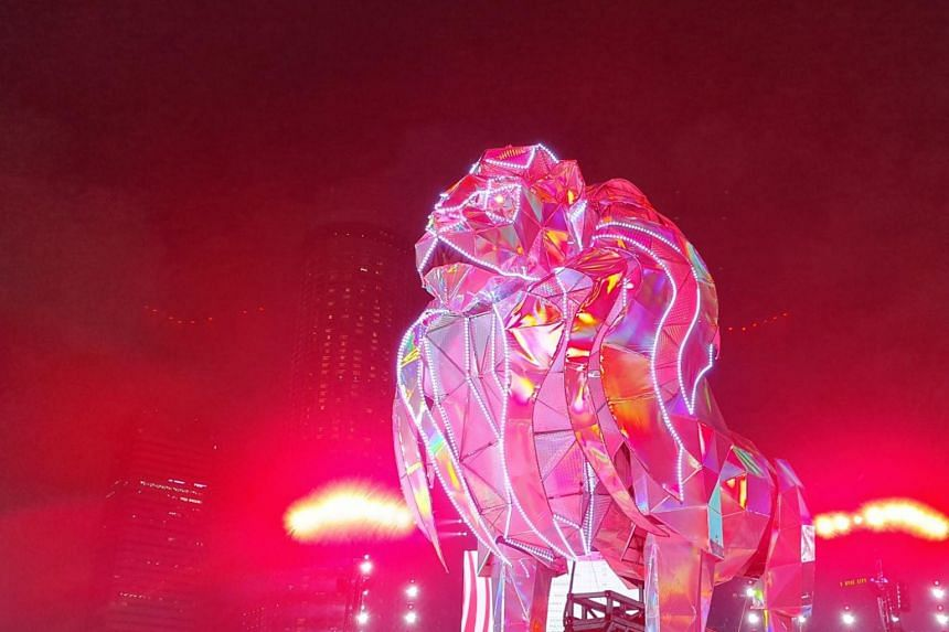 Ten performers are needed to control the massive metallic lion - six to steer it onto the stage and four to control the movement of its legs.