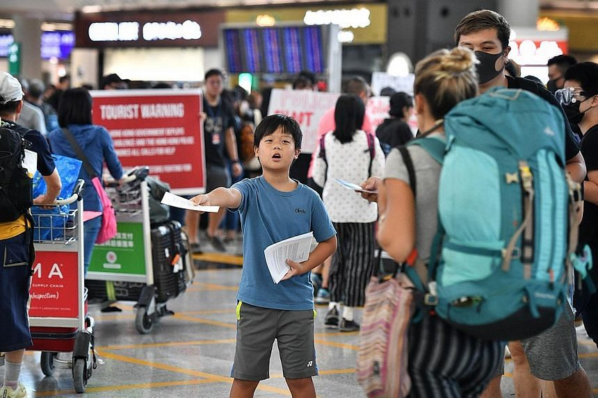 Protesters staging a sit-in yesterday at the Hong Kong airport. In a bid to find new ways to spread their message, the protesters, who included aircrew and workers from the aviation industry, converged on the Terminal 1 arrival hall of one of Asia's