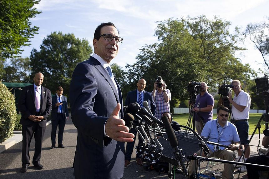US Treasury Secretary Steven Mnuchin (centre) outside the White House. Mr Mnuchin and other Trump administration officials will visit Shanghai next week for trade talks with China. PHOTO: EPA-EFE