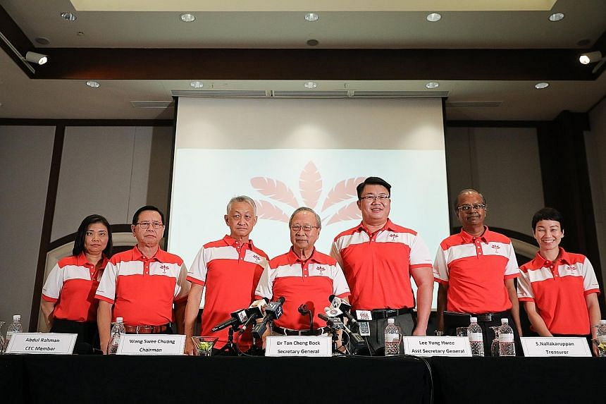 Progress Singapore Party secretary-general Tan Cheng Bock (centre) with (from left) assistant treasurer Hazel Poa, Central Executive Committee (CEC) member Abdul Rahman, chairman Wang Swee Chuang, assistant secretary-general Lee Yung Hwee, treasurer