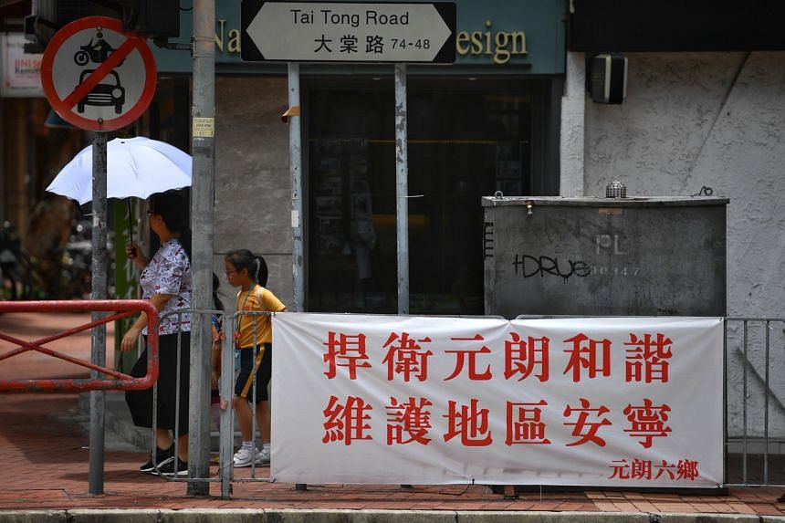 A banner asking people to defend and preserve the harmony and peace in Yuen Long.