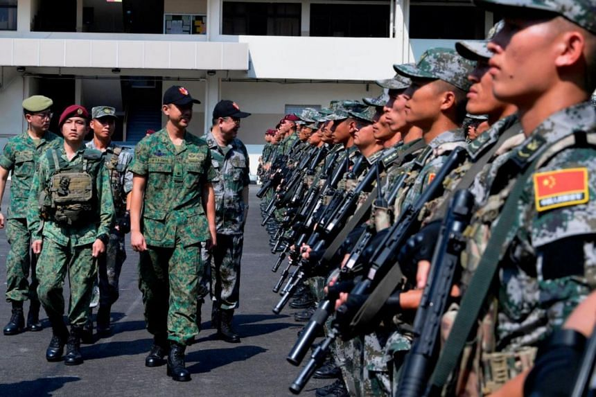 Exercise Cooperation involves about 240 soldiers from the Singapore Army's 3rd Singapore Divison and 1st Commando Battalion, as well as the People's Liberation Army Southern Theater Command Army's 74th Army Group.