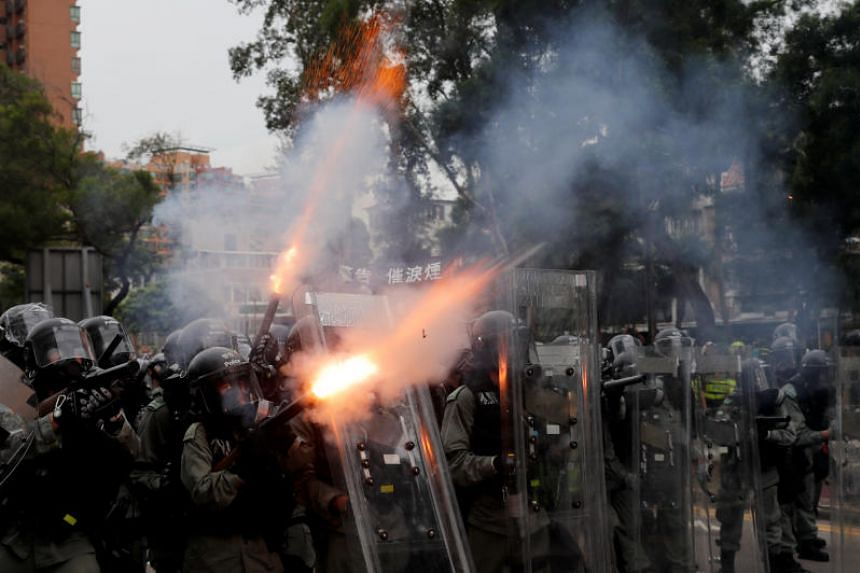 Police officers firing tear gas at demonstrators during a protest in Yuen Long on July 27, 2019.