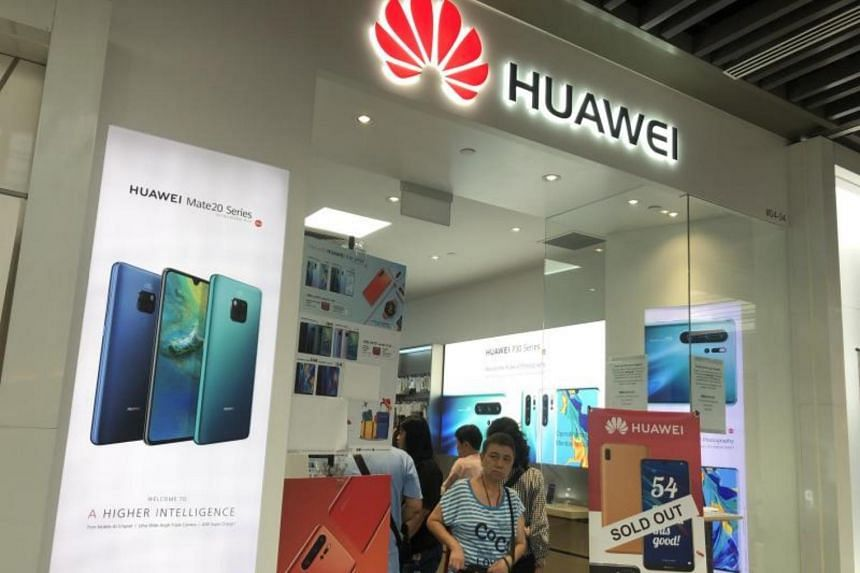 A sign outside a Huawei store in Jem telling customers that the Huawei Y6 Pro being sold at $54 is now out of stock, on July 27, 2019.