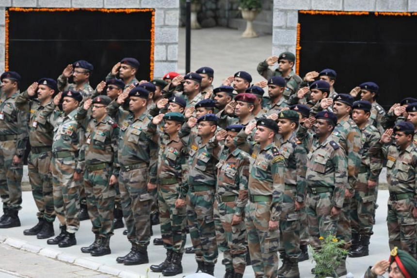 Indian army officers paying tribute on the 20th anniversary of the Kargil Victory Day in Srinagar, Indian Kashmir, on July 26, 2019. India is moving an additional 10,000 paramilitary personnel to the troubled region.