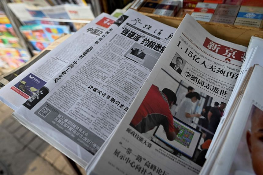 Chinese newspapers reporting on the death of former premier Li Peng are seen in Beijing on July 24, 2019.